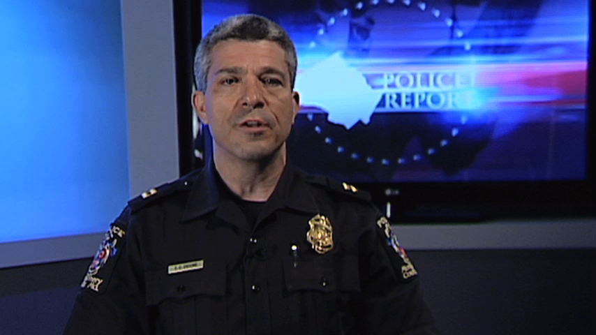 Image of police officier making a report on TV