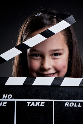 Image of girl with clapper for Digital Video Camp from August 6th through August 17 at Montgomery Community Media
