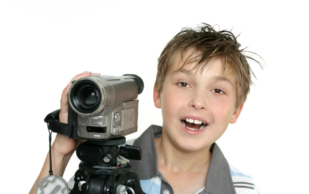 Image of boy with video camera for Digital Video Camp at Montgomery Community Media from August 6 to August 17 2012