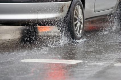 Image of car driving through heavy rain
