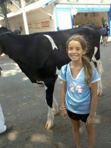 Genevieve Reineke and cow at the Montgomery County Agricultural Fair