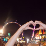 Image of hands in heart pose at Fair