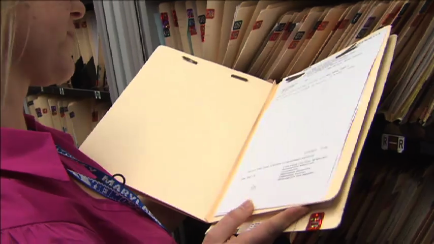 person holding paper file