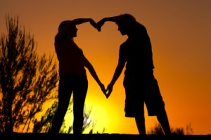 Teen couple forming a heart