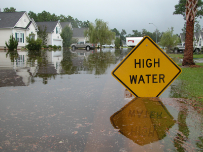 High Water sign street flooded