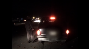 Police stop car at alcohol checkpoint