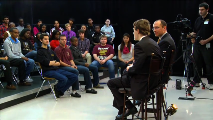 Photo Dr. Starr and students at Paint Branch Student Town Hall