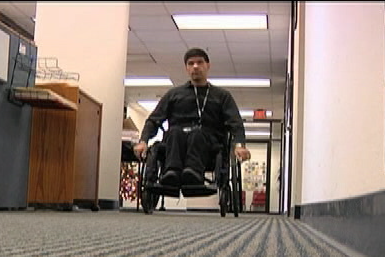 photo of employee in wheelchair at workplace