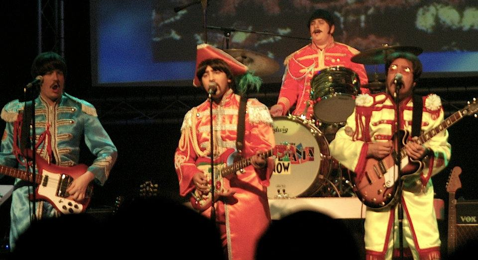photo Beatlemania performing on stage