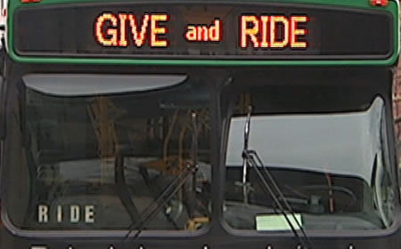 photo ride on bus with give and ride sign
