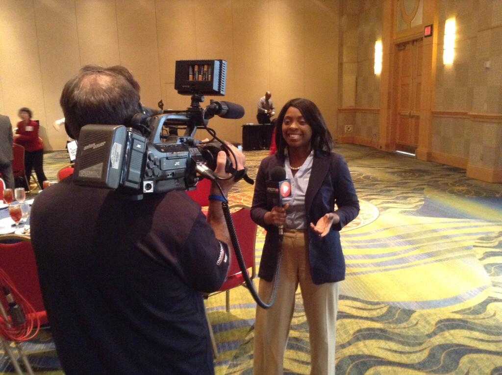 Montgomery Community Media's Engagement Specialist Tamika Smith covering the inaugural Small Business Awards in Bethesda.