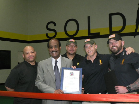"""Montgomery County Executive Isiah """"Ike"""" Leggett presents a county certificate commemorating the grand opening of the """"Soldierfit Fort Gym"""" on May 31, 2013. Pictured is Russell Duvall, Soldierfit Executive Officer; Montgomery County Executive Isiah """"Ike"""" Leggett Geraldo Martin, Soldierfit General Manager and Dave Posin & Danny Farrar, Soldierfit Founders/Owners (l:r).  Photo 