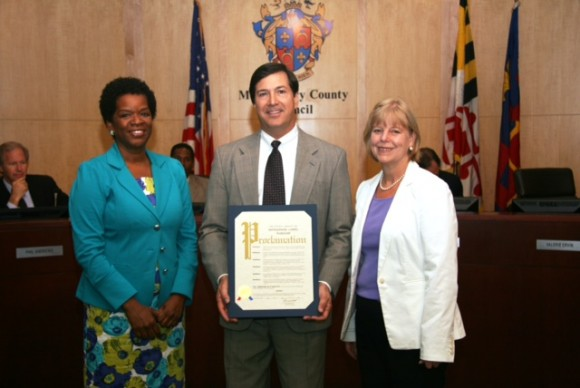 On July 9, Montgomery County Councilmembers Valerie Ervin (left) and Nancy Floreen presented a proclamation on behalf of the Council to Greg Ten Eyck, the director of public affairs and government relations for Safeway, thanking the company for keeping with the County's environmentally conscious initiatives.
