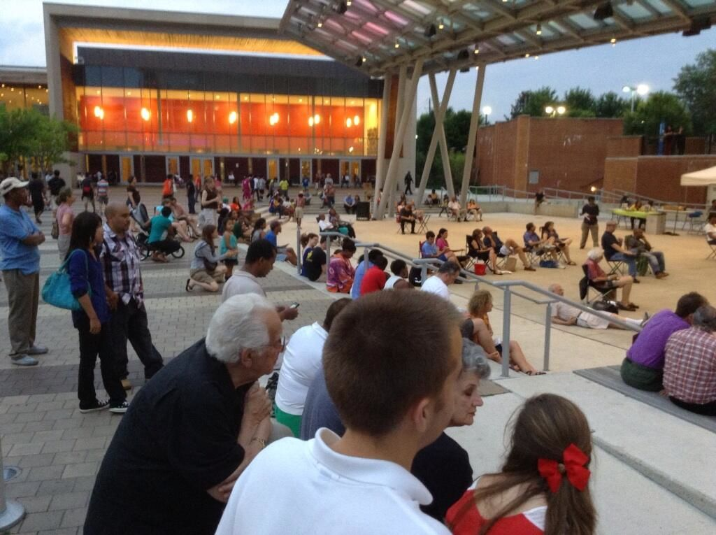Crowd at Veteran's Plaza listen to Bruce Ewan, The Red Harmonica Man