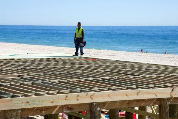 Construction crew working on walking pier at the end of the boardwalk