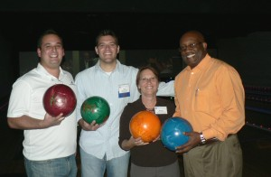 """(l:r) Brett Friedman, Peak Investment Advisors, Inc., Gary Aughinbaugh, AETEA Information Technology, Inc., Marilyn Balcombe, Gaithersburg-Germantown Chamber Executive Director and Michael Richardson, Mid-Atlantic Federal Credit Union enjoyed """"bowling with a twist"""" at the 2nd Annual Bowling with the Board. (photo credit: Laura Rowles, GGCC Director of Marketing)"""