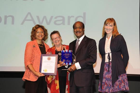 Education Award winner, Betty Scott, Strathmore, with County Executive and Mrs. Leggett Photo | Clark W. Day