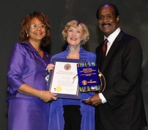 Carol Leahy Receiving 2012 Lifetime Achievement Award Mrs. Catherine Leggett, Carol Leahy and County Executive Isiah Leggett