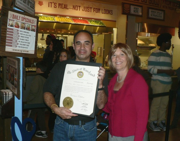 """(l:r) Cafe Rio Mexican Grill General Manager Xavier Villarvoel accepts the """"Governor's Citation"""" from GGCC Executive Director Marilyn Balcombe commemorating their grand opening. (Photo credit – Laura Rowles, Director of Events and Marketing)"""