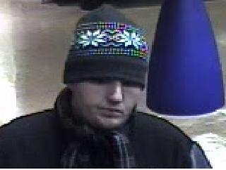 Bank robbery suspect.  Photo | MCPD