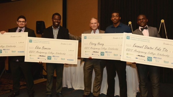 2014 GGCC Montgomery College Scholarship recipients -Erick Garcia, Edem Bamezon, Fitzroy Henry and Emmanuel Foko Tito with Hughes Network Systems Assistant Vice President Jim Muir (center)- at the Gaithersburg-Germantown Chamber of Commerce Annual Celebration Dinner and Awards Ceremony held this month. Photo | John Keith