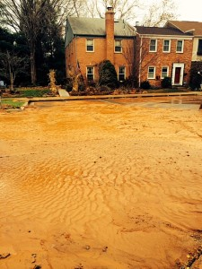 A portion of the parking lot at Shady Grove Village is covered by mud after the water main break.