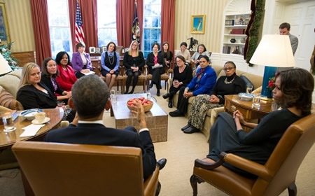 President Barack Obama and First Lady Michelle Obama meet with moms in the Oval Office. Photo courtesy White House.