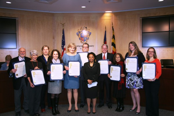 At the ceremony were Silver Spring civic and business leaders, left to right: Mel Tull, Helen Nolan, Connie Rhind Robey, Stephanie Helsing, Jane Redicker, Silver Spring Regional Center Director Reemberto Rodriguez, Councilmember Cherri Branson, Bruce Lee, Rebecca Silvestre, Laura Alin and Alla Shtipelman.