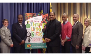 photo county executive ike leggett presenting procalmation to Three Little Birds cast and artistic director