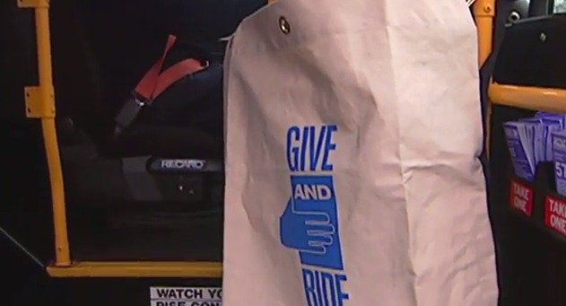 photo of collection bag on bus for Give and Ride food drive