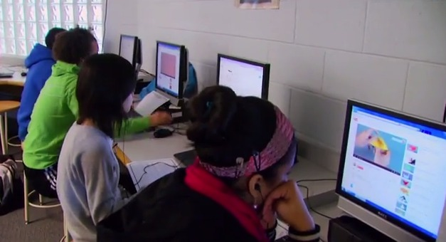 photo Students online at school media center