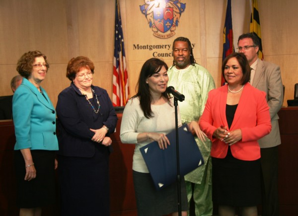 photo of At the ceremonies in Rockville, left to right, were: Judy Ackerman, vice president and provost of the Montgomery College Rockville campus; Carolyn Terry and Rodney Redmond, instructional deans for humanities; Councilmember Nancy Navarro; and Mike Mills, director of the Distance Learning Association.