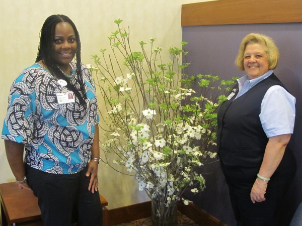 Riderwood, the Erickson Living retirement community, received three bouquets of flowers courtesy of musician and entrepreneur Sean 'P Diddy' Combs.  Employees Simone Gomez (left) and Debra Vinh (right) are pictured with one of the bouquets.