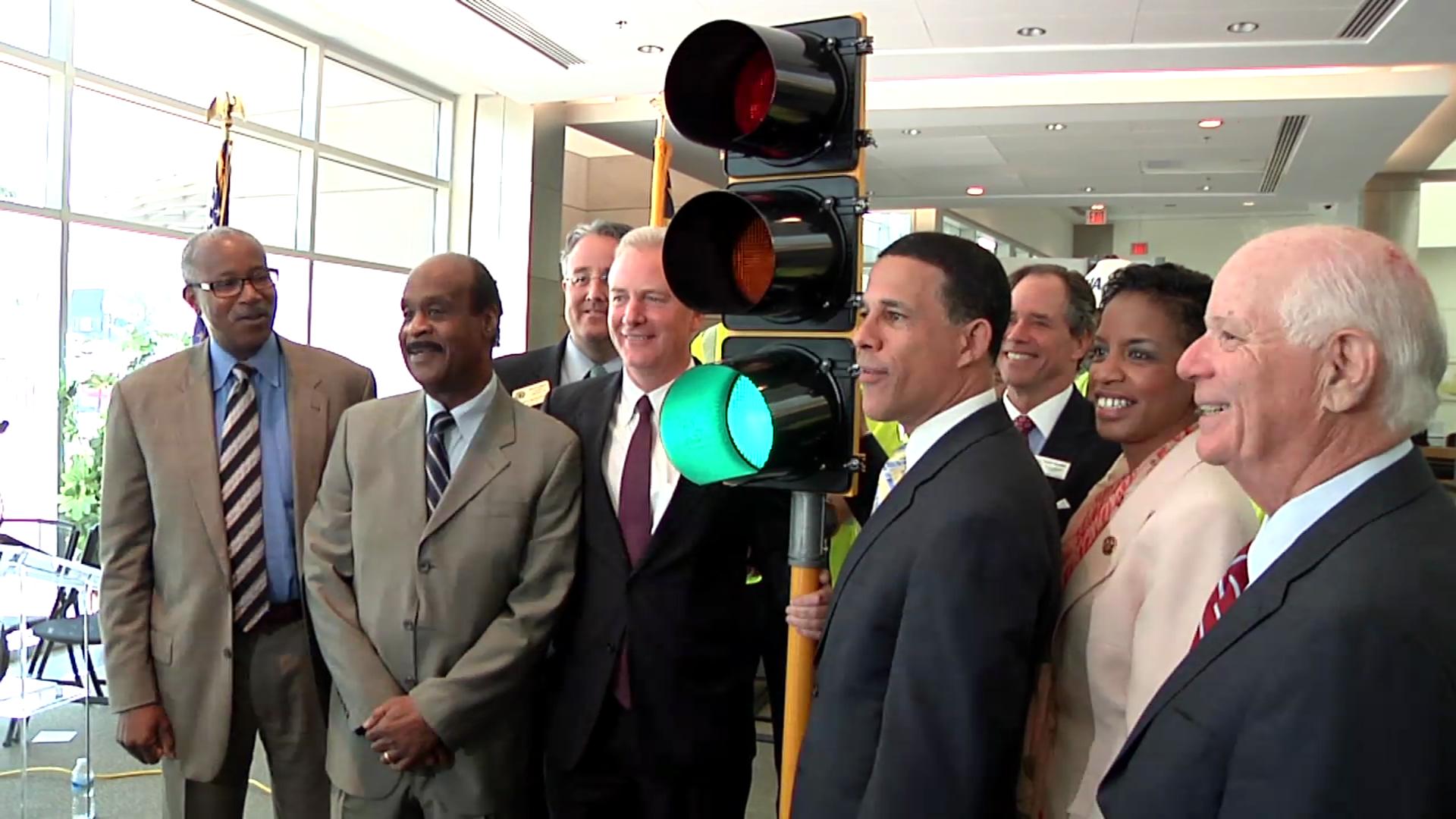 photo of officials green lighting cedar lane BRAC improvements