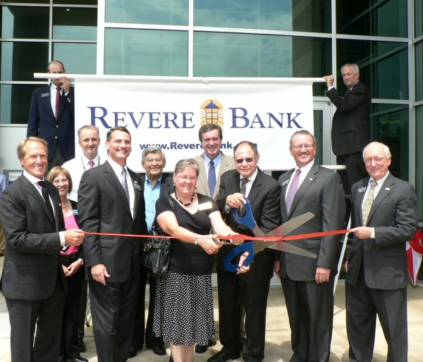 (l:r) Henry Posko, Director, Revere Bank; Marilyn Balcombe, GGCC Executive Director; Terry Forde, President & Chief Executive Officer, Adventist HealthCare; Kenneth Cook, President & Vice Chairman, Revere Bank; Sidney Kramer, former County Executive & State Senator; Cathy Drzyzgula, City of Gaithersburg Councilmember; Doug Duncan, Regional Board Member, Revere Bank and Candidate, Montgomery County Executive; Mayor Sidney Katz, City of Gaithersburg Mayor; Andrew Flott, Chief Executive Officer, Revere Bank; Richard Yocum, Director, Revere Bank at the Gaithersburg-Germantown Chamber conducted Ribbon Cutting Ceremony for Revere Bank in Gaithersburg on June 13, 2014.  (Photo credit – Laura Rowles, GGCC Director of Events & Marketing)