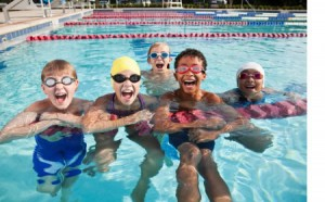 photo of youth in pool with happy faces