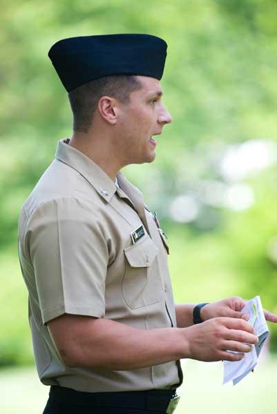 E5 Jason Rynkiewitz, US Navy, announcing pairings on the 1st Tee