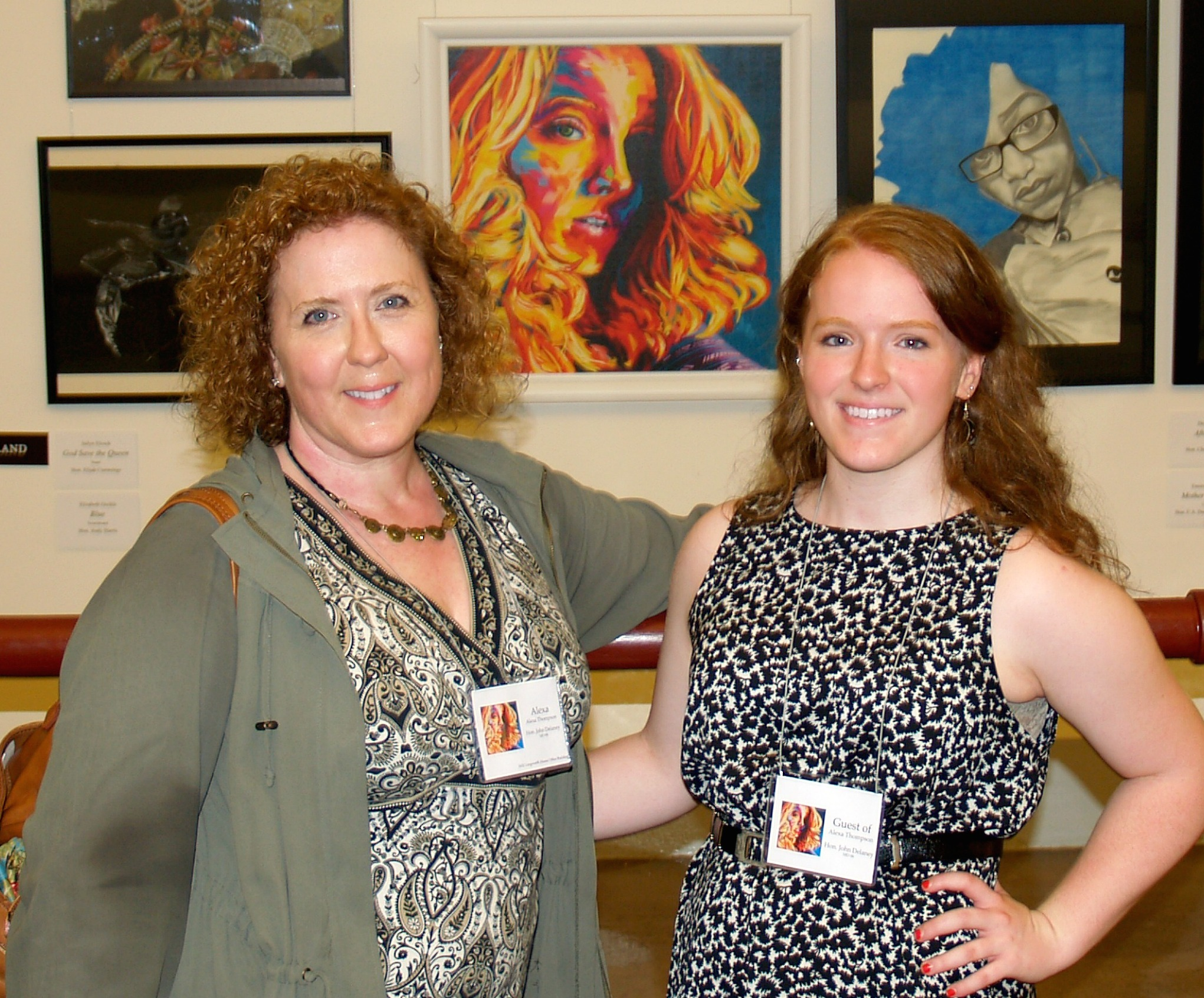 Alexa Thompson poses with her mother and her winning portrait in the U.S. Capitol.