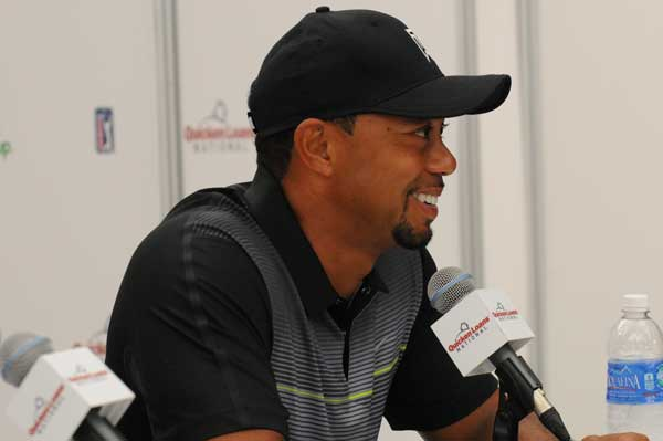 A smiling Tiger Woods