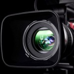 photo of TV camera looking into the lens