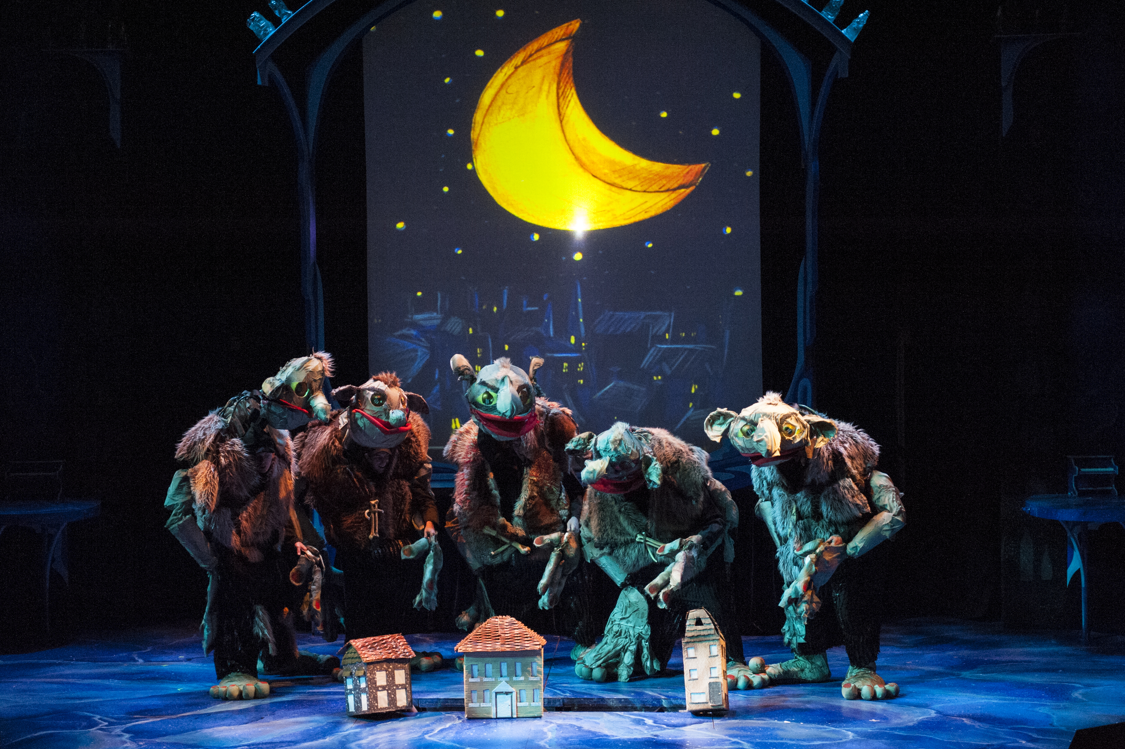 photo of The mean giants of Giant Country plot their next move during The Witching Hour in THE BFG at Imagination Stage through August 10.