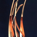 photo of bent wood art piece by Len Harris entitled Gaggle