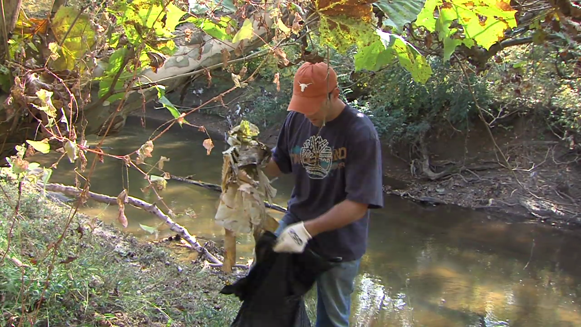 photo of person cleaning up Little Falls