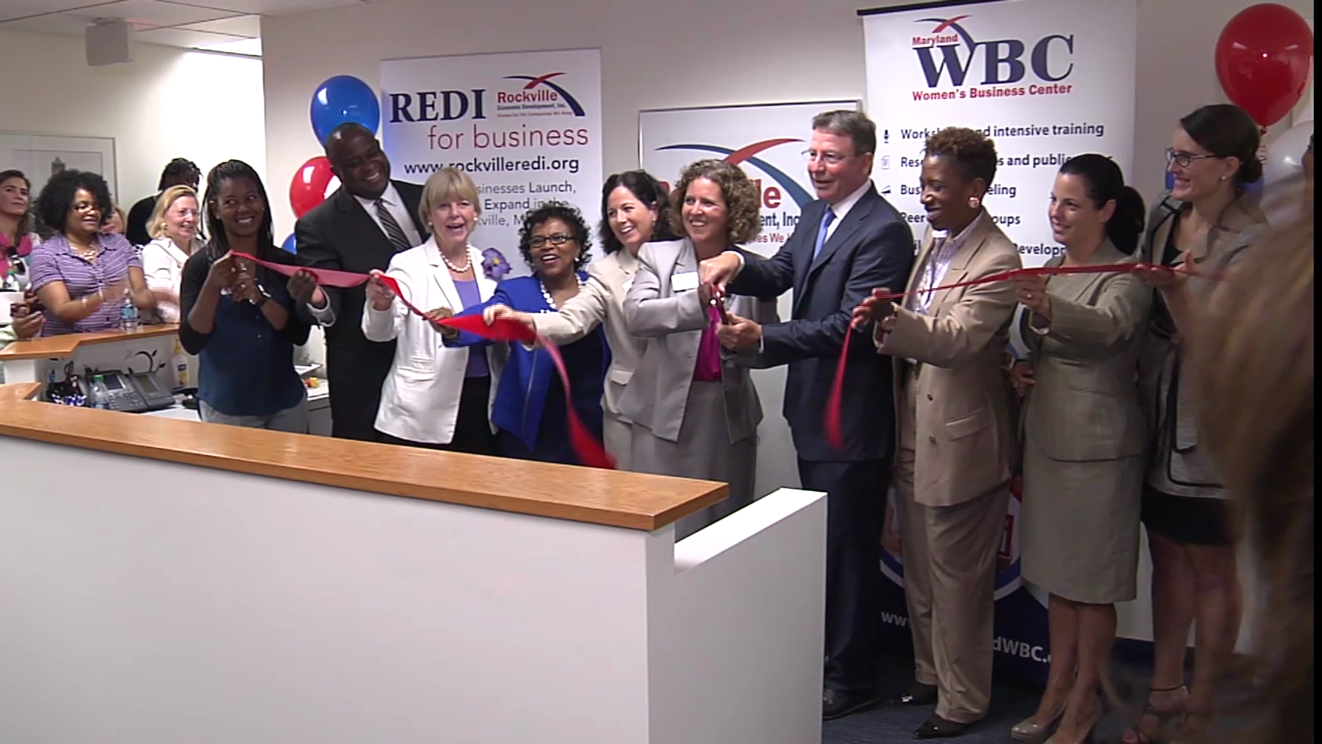 photo of ribbon cutting at new offices for Rockville Economic Development Center and Maryland Women's Business Center