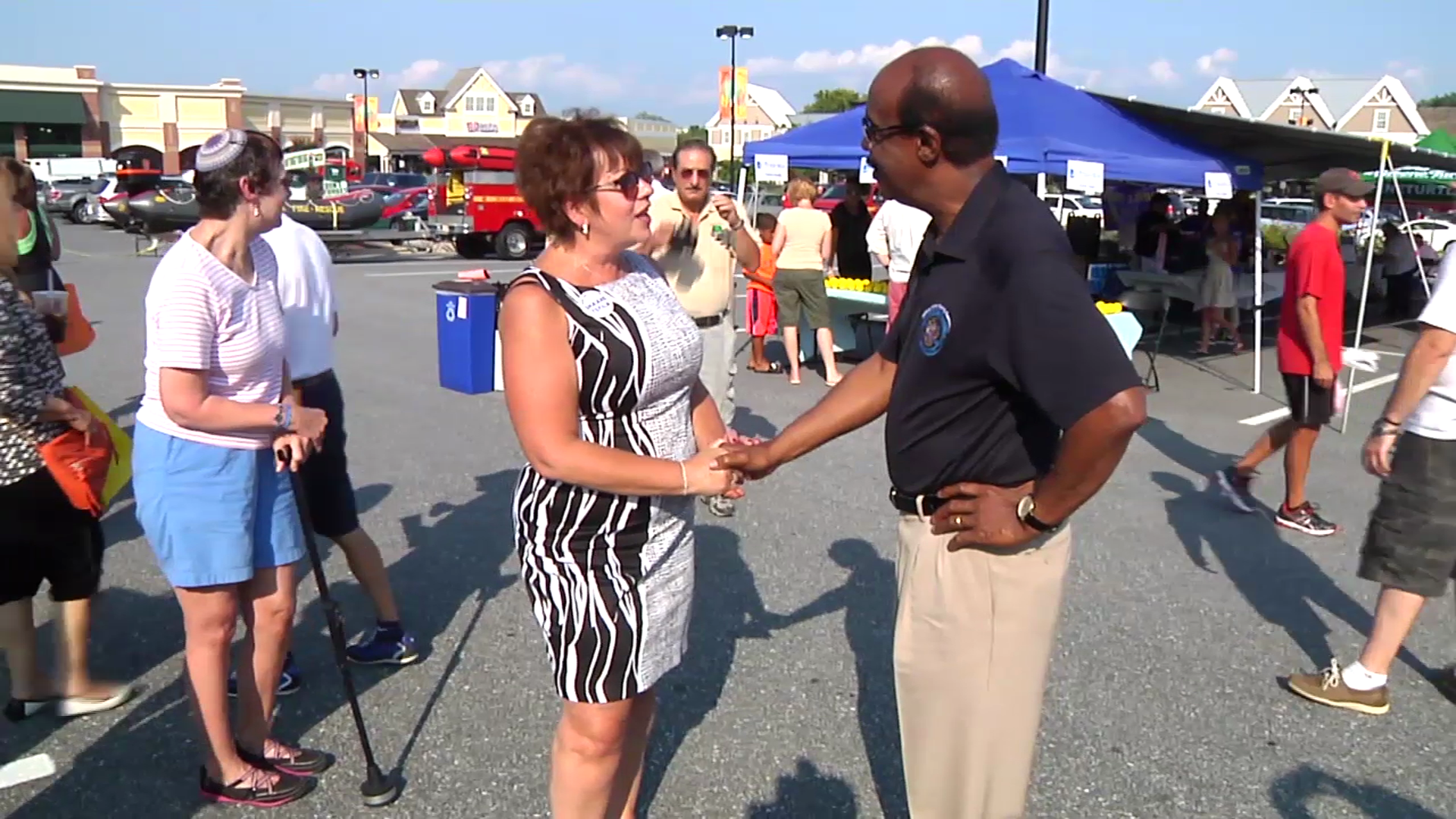 photo of County Exec Leggett talking with Olney resident at National Night Out Aug 5