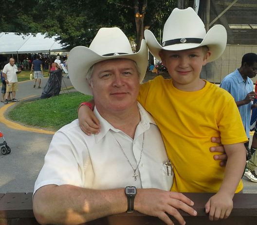 photo of father and son at Montgomery County Agricultural Fair