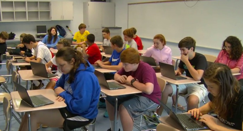 photo of MCPS students using new chrome books
