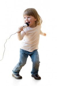 photo of toddler singing into a microphone