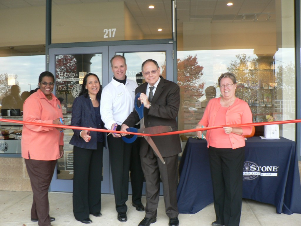 (l:r) Colette Releford, The Gazette and GGCC Board member; Kay Hechler & John Phillips, Hand and Stone Massage and Facial Spa owners; Sidney Katz, City of Gaithersburg Mayor and Cathy Drzyzgula, City of Gaithersburg Councilmember at the Gaithersburg-Germantown Chamber conducted Ribbon Cutting Ceremony for Hand and Stone Massage and Facial Spa on October 31, 2014. (Photo credit – Marilyn Balcombe, GGCC Executive Director)