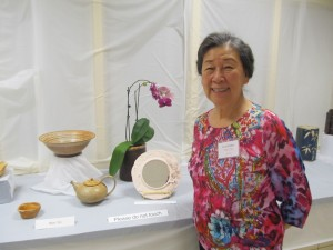Won Yin, a resident of Riderwood and experienced ceramics teacher, displays her work at the 2nd Annual Art of Ceramics Exhibition in November.